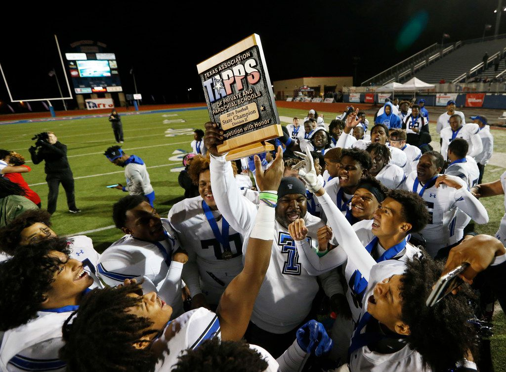 Trinity Christian's head coach Andre' Hart celebrates with the team as he passes the trophy to them after they defeated Austin Regents 48-19 in the TAPPS Division II State Championship game at Waco Midway's Panther Stadium in Hewitt, Texas on Friday, December 6, 2019. Trinity Christian defeated Austin Regents 48-19. (Vernon Bryant/The Dallas Morning News)