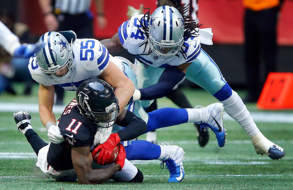 Dallas Cowboys outside linebacker Leighton Vander Esch (55) and middle linebacker Jaylon Smith (54) combine for the tackle of Atlanta Falcons wide receiver Julio Jones (11) during the third quarter at Mercedes-Benz Stadium in Atlanta, Sunday, November 18, 2018. The Cowboys pulled out a 22-19 win. (Tom Fox/The Dallas Morning News)