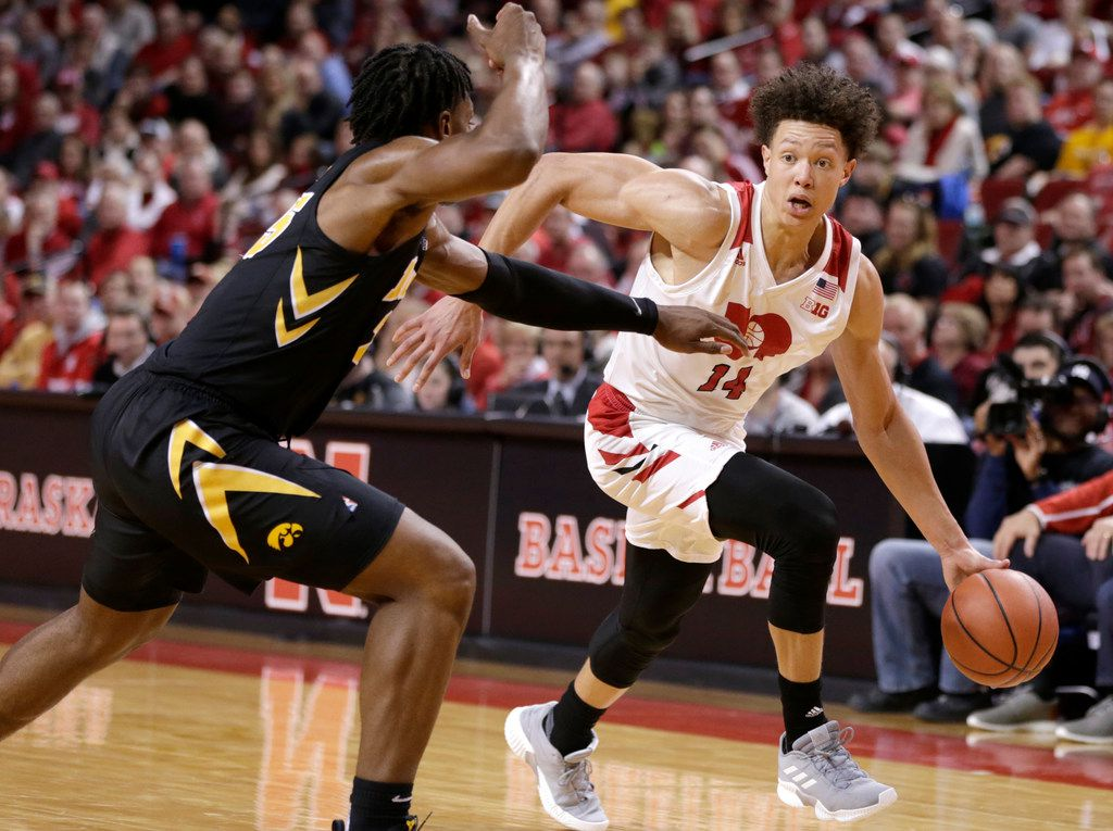Nebraska's Isaiah Roby (14) drives to the basket against Iowa's Tyler Cook, during the second half of an NCAA college basketball game in Lincoln, Neb., Sunday, March 10, 2019. Nebraska won 93-91 in overtime. (AP Photo/Nati Harnik)
