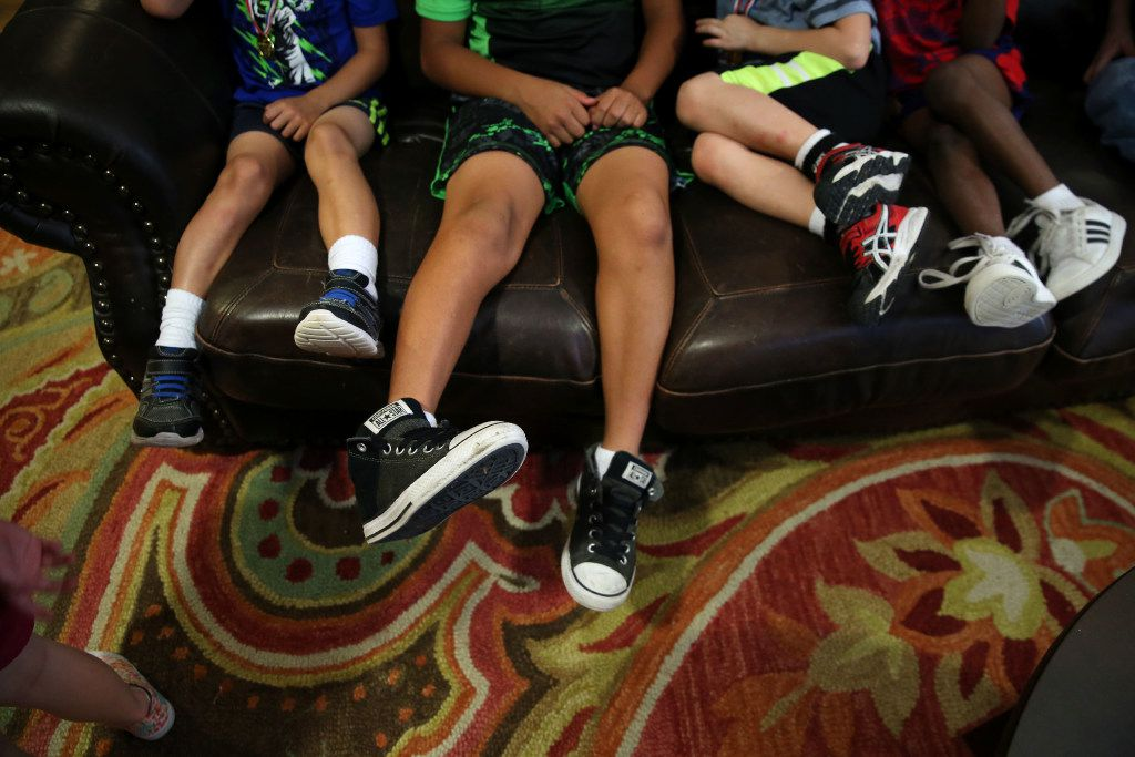 Boys sit on the couch at Jonathan's Place, which serves abused and neglected children, in Garland on Friday, June 30, 2017.