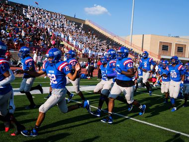 Duncanville players take the field to face St. John's College (D.C.) in a high school football game on Saturday, Sept. 14, 2019, in Duncanville.
