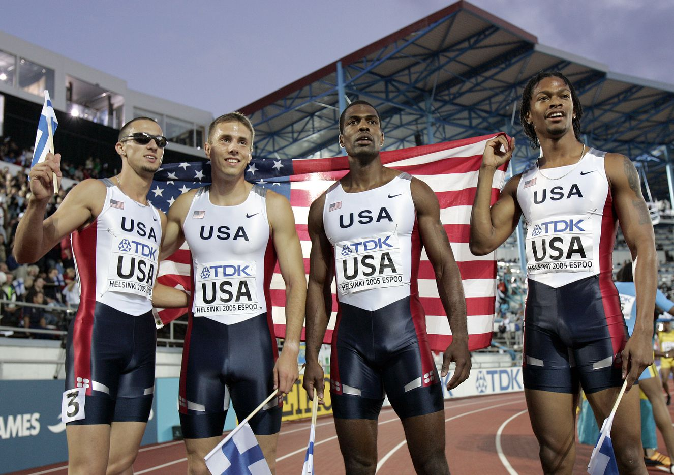 From 2005: The gold medal winning US team, from left: Jeremy Wariner, Andrew Rock, Derrick Brew and Darold Williamson during their victory lap after the Men's 4x400 meter relay final at the World Athletics Championships in Helsinki, Finland, Sunday, Aug. 14, 2005.