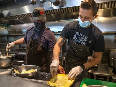 From left, executive sous chef Justin Huynh and sous chef Blake Nolan prepare a vegetable lasagna at Gemma American bistro in Dallas on Wednesday, Sep. 23, 2020.