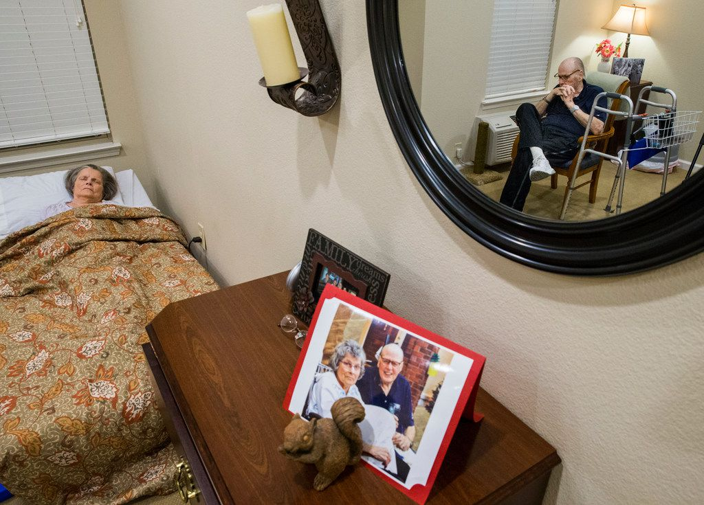 A recent photo is displayed on a dresser as Bob Stiegler sits with his wife, Norma, at Silverado Plano Memory Care Community.