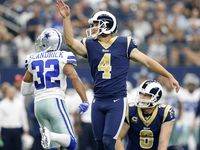 Los Angeles Rams kicker Greg Zuerlein (4) connected on a third quarter field goal against Dallas Cowboys cornerback Orlando Scandrick (32) at AT&T Stadium in Arlington, Texas, Sunday, October 1, 2017.