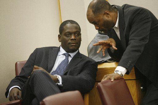 Then-Dallas County District Attorney Craig Watkins talks with prosecutor Gordon Hikel in the courtroom as they observed the proceedings of Johnnie Earl Lindsey's release from prison after 26 years on a wrong conviction. In September 2008,  Lindsey became the 19th man cleared by DNA testing in Dallas County since 2001, when the Legislature began allowing post-conviction DNA testing. Lindsey was misidentified by an eyewitness.