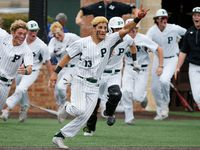 Gabriel Colina (13) leads his team sprinting out of the dugout after completing a come from behind win in their last at bat as Prosper High School hosted Arlington Martin High School in a series final 6A Region I area round playoff game on Saturday afternoon, May 15, 2021.