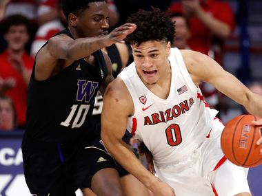TUCSON, AZ - MARCH 07: Washington Huskies guard Elijah Hardy (10) defends Arizona Wildcats guard Josh Green (0) during the second half of the college basketball game at McKale Center on March 7, 2020 in Tucson, Arizona.