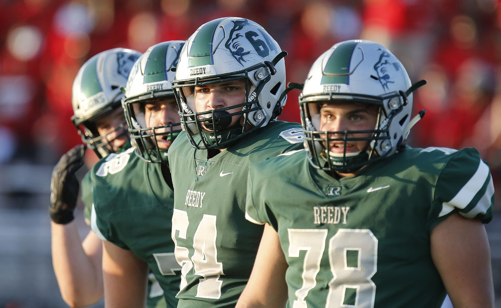 The Reedy High School offensive line looks to the sideline for signals from the coaches during the first half as Reedy High School hosted Frisco Liberty High School at David Kuykendall Stadium in Frisco on Wednesday night, August 26, 2021. (Stewart F. House/Special Contributor)