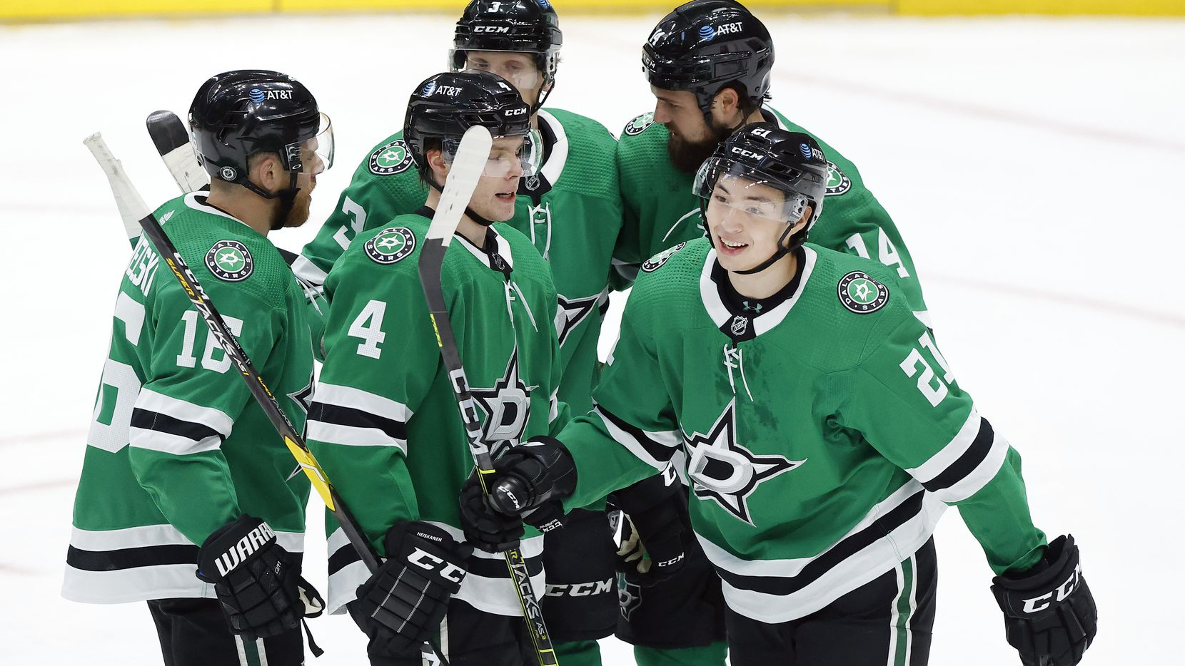 Stars left wing Jason Robertson (21) is congratulated by teammates after scoring a first-period goal against the Panthers at American Airlines Center in Dallas on Tuesday, April 13, 2021.