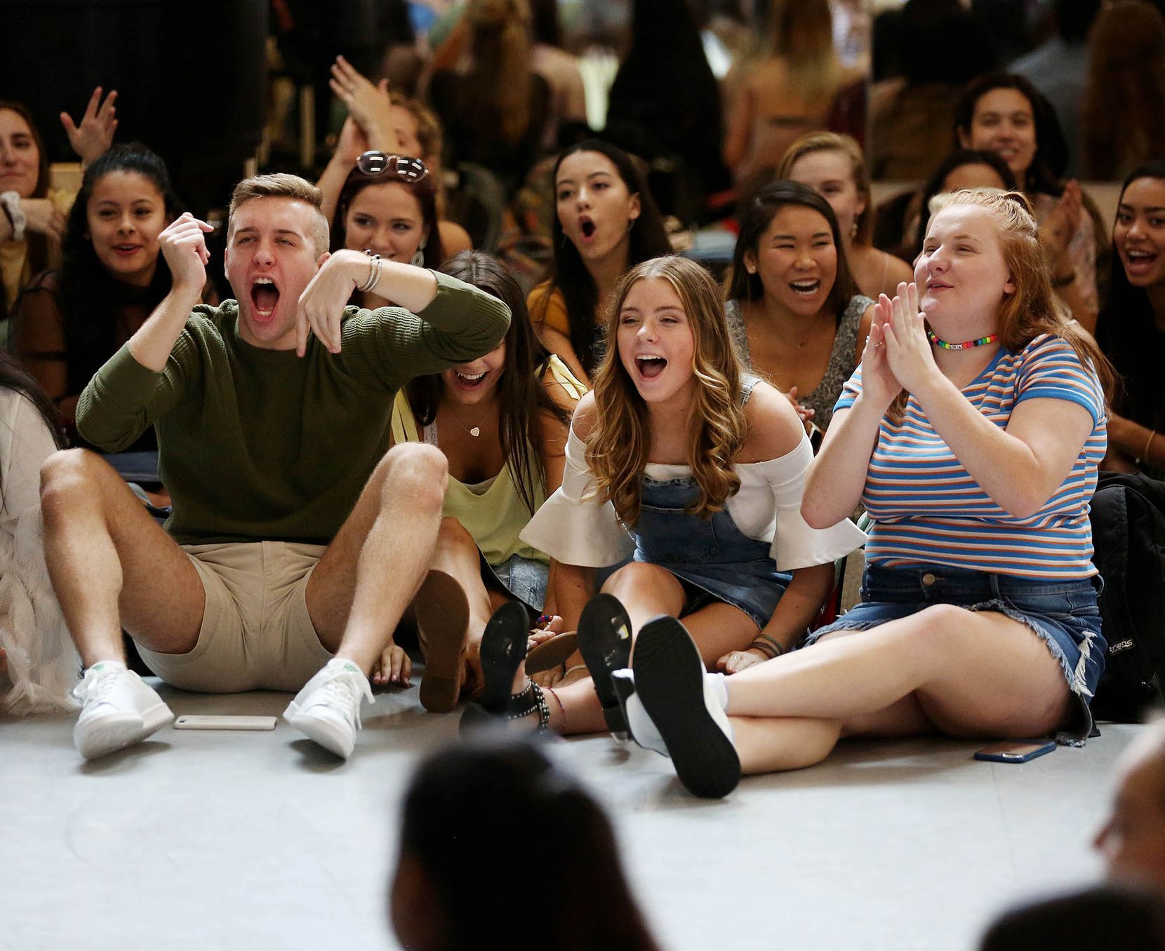 Dance students (from left) Luke Qualls, Kennedy Huff and Shelby Flowers, all seniors, cheer for an announcement during the first dance conservatory homeroom.