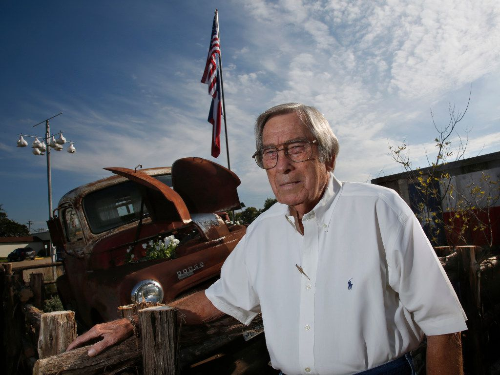 Joe Mapes, owner of Joan's Spot Free Car Wash, stands by a 1950 Dodge pickup truck in front of his business in Irving, Texas. Mapes voted for Donald Trump for president.