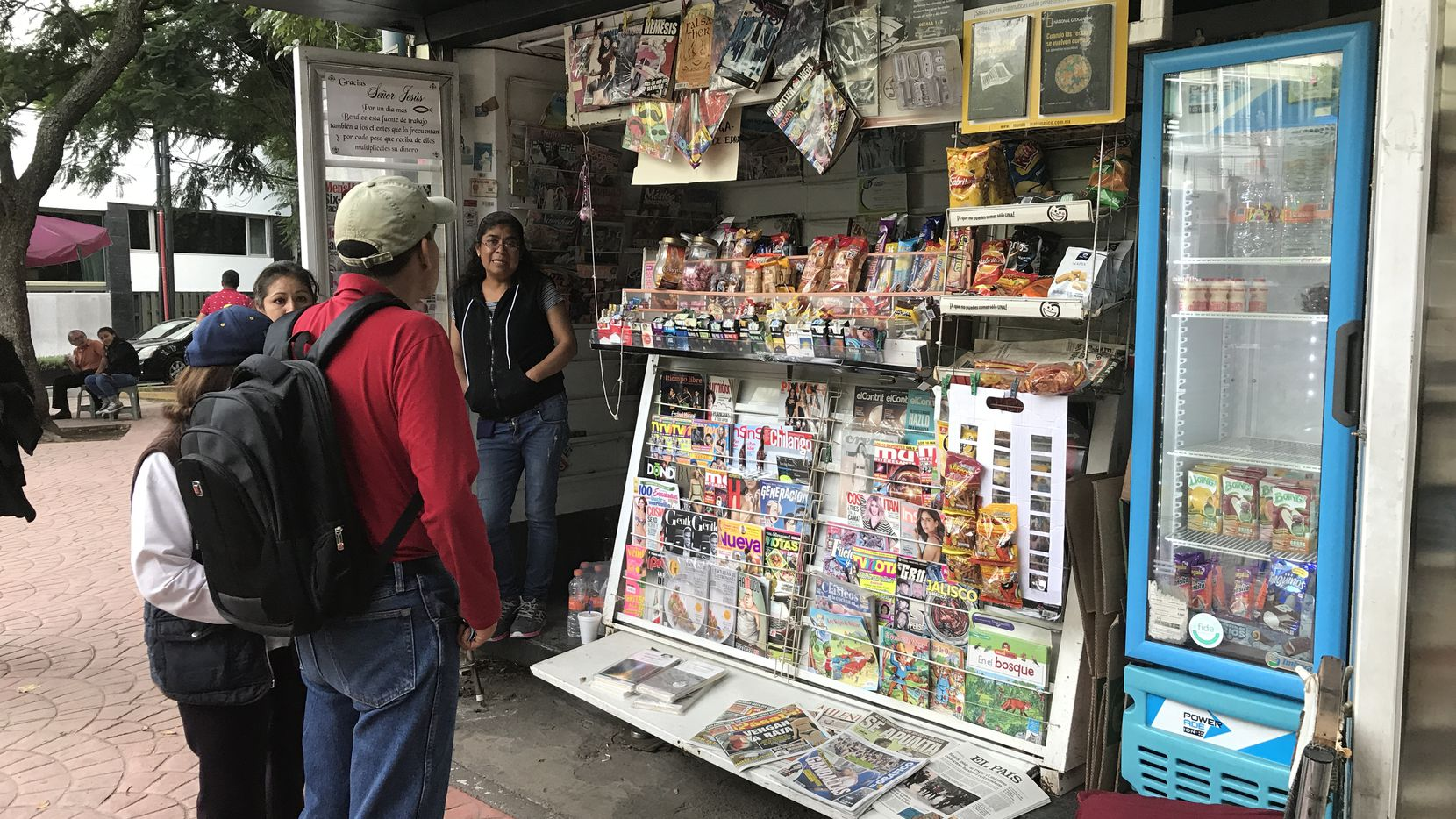 Residents in Mexico City stop at a news stand to take a look at the latest headlines. Stories about government corruption dominate news in Mexico as talks to renegotiate NAFTA begin.