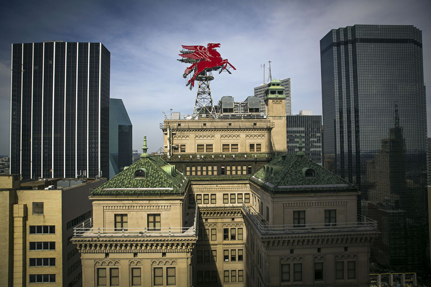 The replacement Pegasus — the second to sit atop the Magnolia building — can be seen from around downtown.