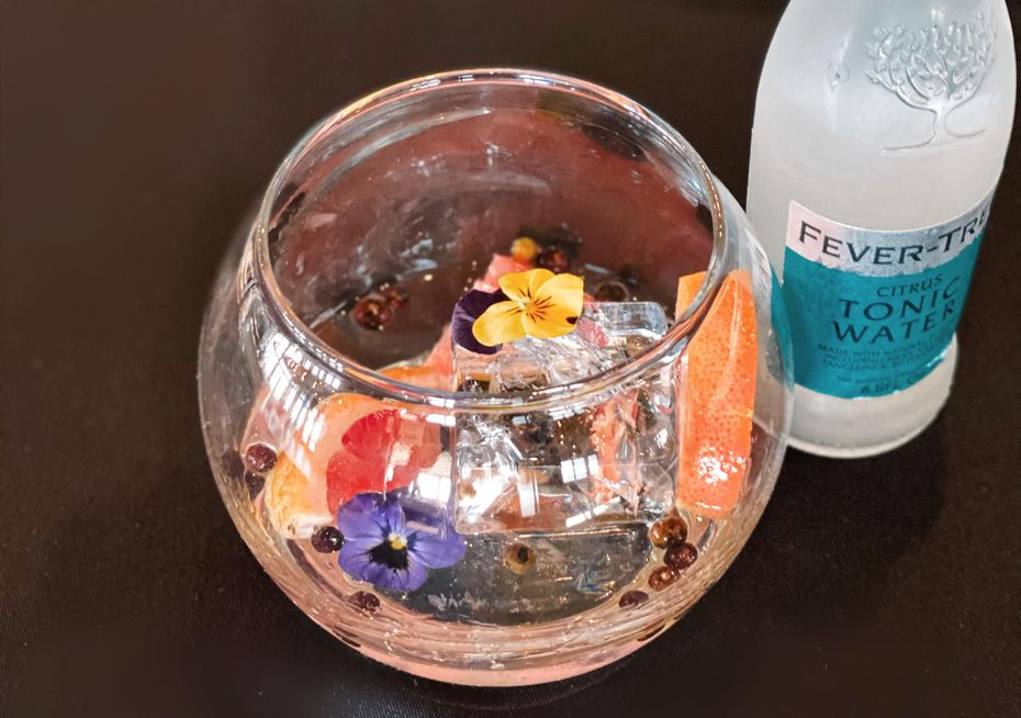 The Sheaside Gin & Tonic   named for husband and wife owners Nathan and Bonnie Shea   is served with edible flowers at Urban Seafood.