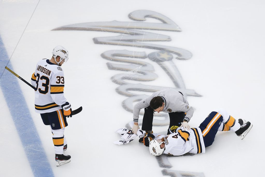 Nashville Predators defenseman Ryan Ellis (4) is assisted after being injured during the first period of a NHL Winter Classic matchup between the Dallas Stars and the Nashville Predators on Wednesday, January 1, 2020 at Cotton Bowl Stadium in Dallas. (Ryan Michalesko/The Dallas Morning News)