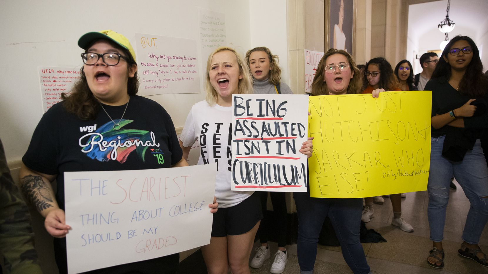 The University of Texas at Austin students chant outside of Executive Vice President and Provost Maurie McInnis' office to demand more accountability and transparency from the university about faculty who have been found guilty of sexual misconduct on Nov. 20, 2019 in Austin.