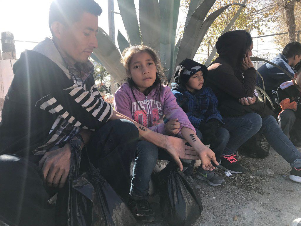 Mateo Mejia Hernandez, 30, and his 9-year-old daughter, Darleen, showed their processing numbers this week at Casa del Migrante, an immigrant shelter in Ciudad Juarez, Mexico.