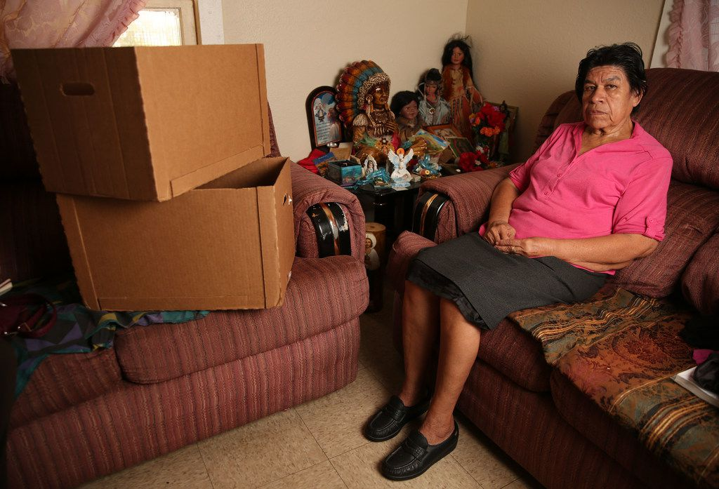 Yolanda Gonzalez was packing Thursday in the HMK rent house she and her husband, Fernando Gonzalez, must vacate on McBroom Street in West Dallas.