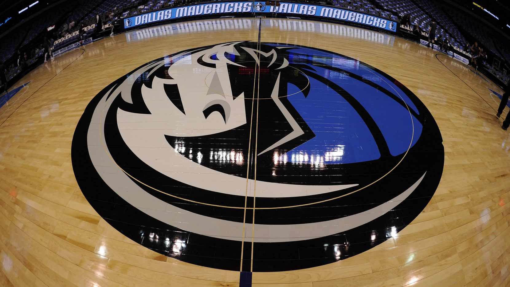 Feb 13, 2013; Dallas, TX, USA; A general view of the Dallas Mavericks logo at center court before the game between the Mavericks and the Sacramento Kings at the American Airlines Center.