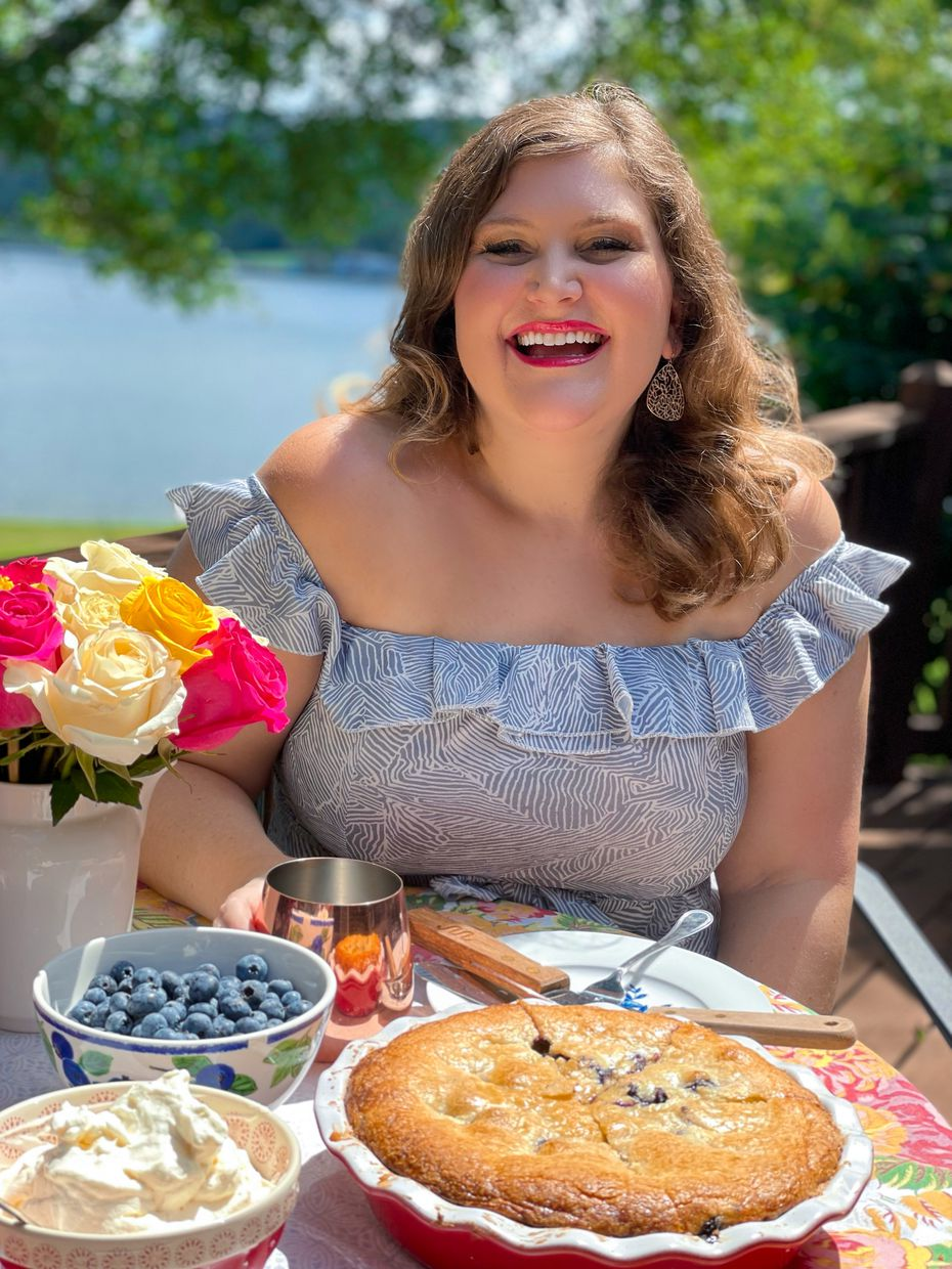 The cover of 'The Rose Table' cookbook shows a dessert that Katie-Rose Watson created at age 17 called Blueberry Hill Surprise. It's a blueberry pie with a sugar-cookie-like crust.