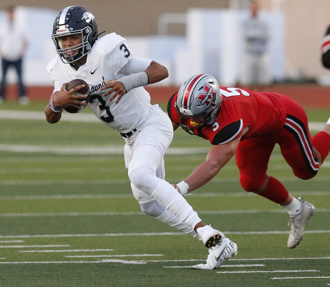 Flower Mound High School quarterback Nick Evers (3) escapes pressure from Flower Mound Marcus High School linebacker Emmerick Dopona (5) during the first half as Flower Mound Marcus hosted Flower Mound High School in a district 6-6A football game at Marauder Stadium in Flower Mound on Friday night, September 24, 2021. (Stewart F. House/Special Contributor)