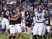 Texas A&M's Seth Small (47) celebrates with Nik Constantinou (95) and Ainias Smith (0) after his game-winning field goal, as Alabama linebackers Dallas Turner (15) and Will Anderson Jr. leave the field after an NCAA college football game Saturday, Oct. 9, 2021, in College Station, Texas.
