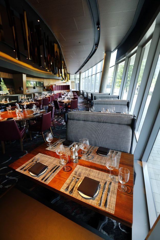 The curved and angled glass exterior provides natural light to illuminate the lower dining area of the new Del Frisco's Double Eagle Steak House in Uptown Dallas, Friday, September 9, 2016. The original, located on Spring Valley since 1994, has closed and the new one opens Saturday. (Tom Fox/The Dallas Morning News)