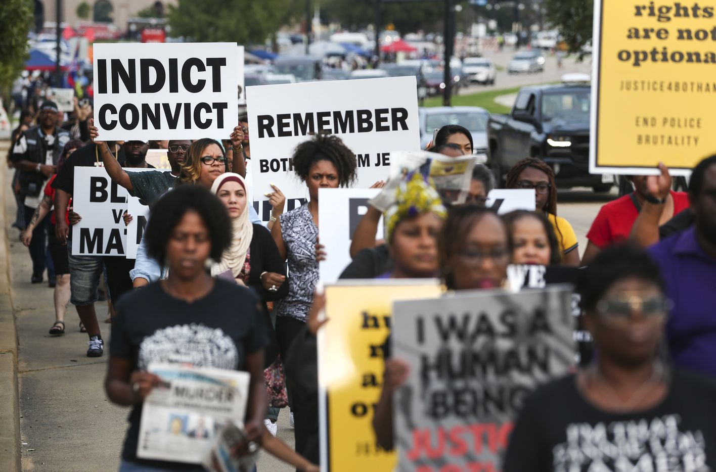 People march during a protest prior to the start of the Dallas Cowboys' game against the New York Giants on Sunday, Sept. 16, 2018 at AT&T Stadium in Arlington, Texas. The demonstration comes after Botham Jean Shem was shot in his home by Dallas police officer Amber Guyger.