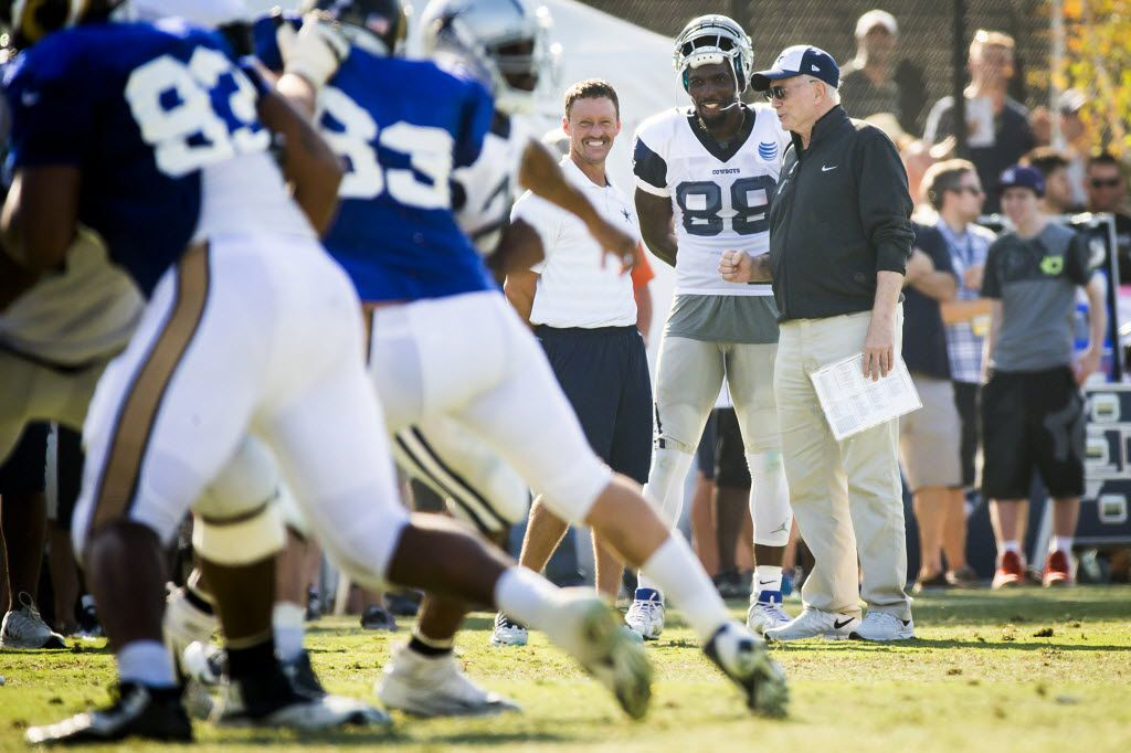 FILE - Dallas Cowboys wide receiver Dez Bryant (88) watches practice from the sidelines with team owner Jerry Jones during a joint practice with the St. Louis Rams at Cowboys training camp on Tuesday, Aug. 18, 2015, in Oxnard, Calif. (Smiley N. Pool/The Dallas Morning News)