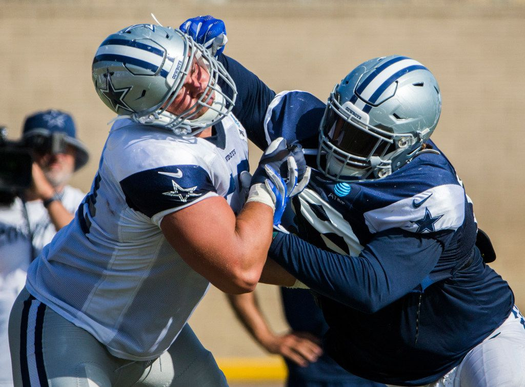 Dallas Cowboys defensive tackle Trysten Hill (79, right) takes on offensive guard Connor Williams (52) during an afternoon practice at training camp in Oxnard, California on Monday, August 12, 2019. (Ashley Landis/The Dallas Morning News)