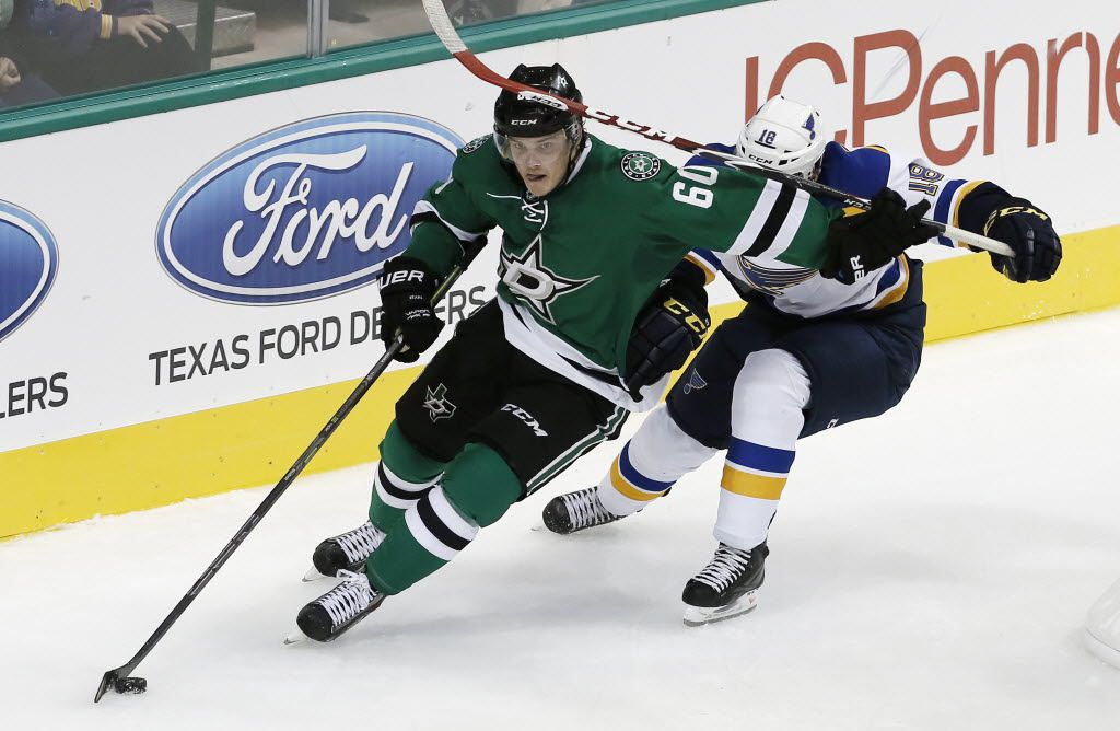 Dallas Stars defenseman Julius Honka (60) battles St. Louis Blues forward Ty Rattie (18) for space during the second period of a pre-season hockey game at the American Airlines Center, Monday, September 22, 2014. (Brandon Wade/Special Contributor)