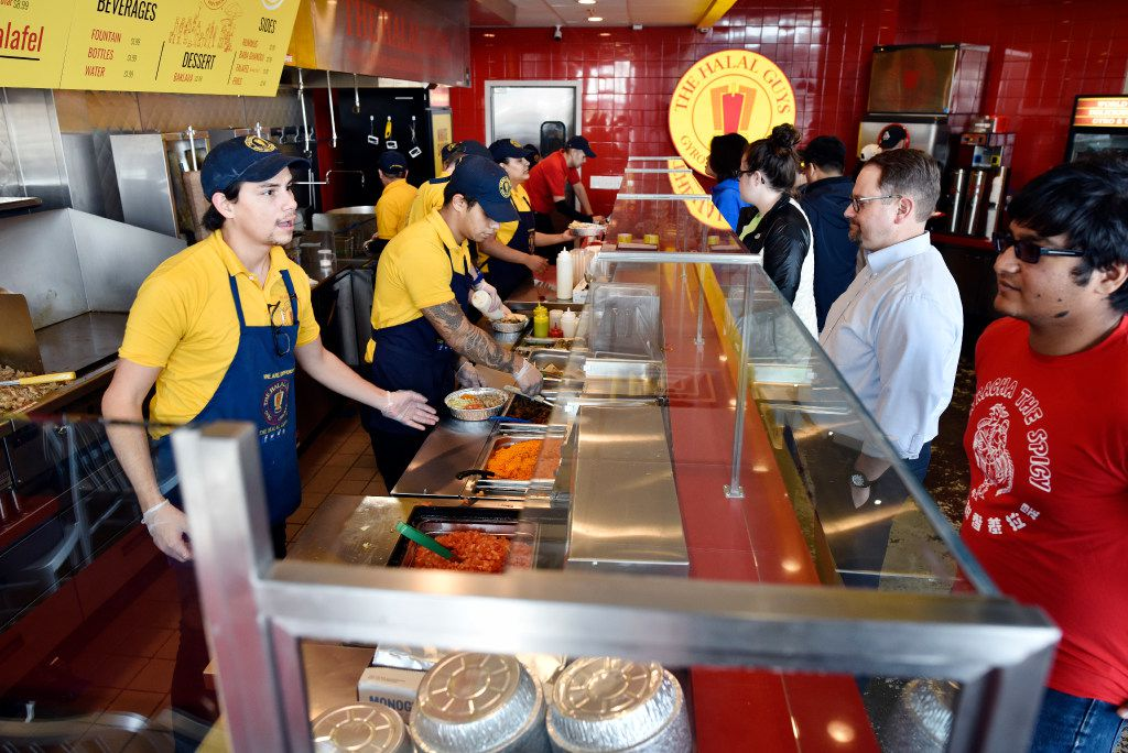 Food server Elijah Layton, left, takes an order from Amann Islam at the new The Halal Guys restaurant in Richardson, Friday, Feb. 10, 2017. Ben Torres/Special Contributor
