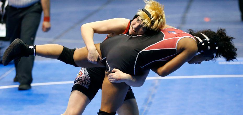 Euless Trinity's Mack Beggs lifts Tascosa's Mya Engert in the 6A girls 110 weight class during the UIL Wrestling State Tournament at Berry Center in Cypress on Friday, February 24, 2017. Beggs defeated Engert 12-4 to advance to the semifinal. (Vernon Bryant/The Dallas Morning News)
