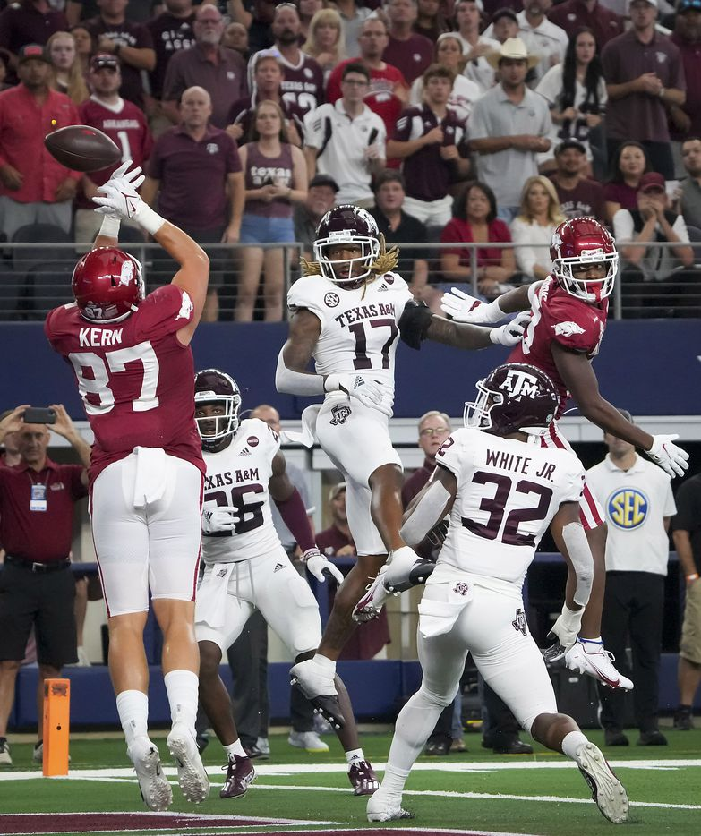 Arkansas tight end Blake Kern (87) has a pass go off his hands in the end zone as Texas A&M defensive back Demani Richardson (26), defensive back Jaylon Jones (17) and linebacker Andre White Jr. (32) defend during the second half of an NCAA football game at AT&T Stadium on Saturday, Sept. 25, 2021, in Arlington. Arkansas won the game 20-10.