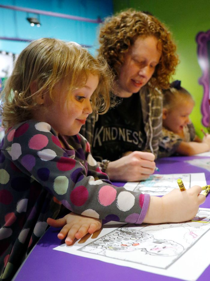 Anna Horton, 3, colors with her mother, Robin Horton, during the grand opening of the Crayola Experience Plano.