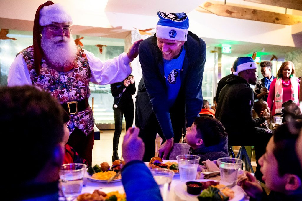 Dirk Nowitzki, here having fun with kids at a Christmas party earlier this month, spent Friday at Children's Medical Center Dallas for his annual appearance as Santa Dirk.  (Shaban Athuman/The Dallas Morning News)