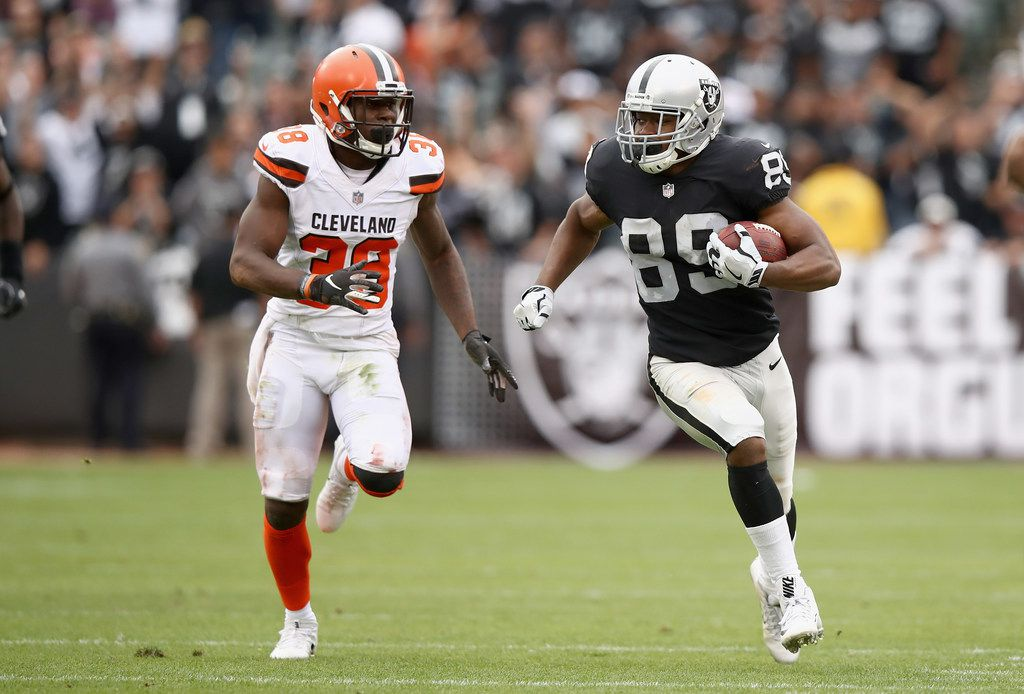 OAKLAND, CA - SEPTEMBER 30:  Amari Cooper #89 of the Oakland Raiders tries to outrun T.J. Carrie #38 of the Cleveland Browns at Oakland-Alameda County Coliseum on September 30, 2018 in Oakland, California.  (Photo by Ezra Shaw/Getty Images)