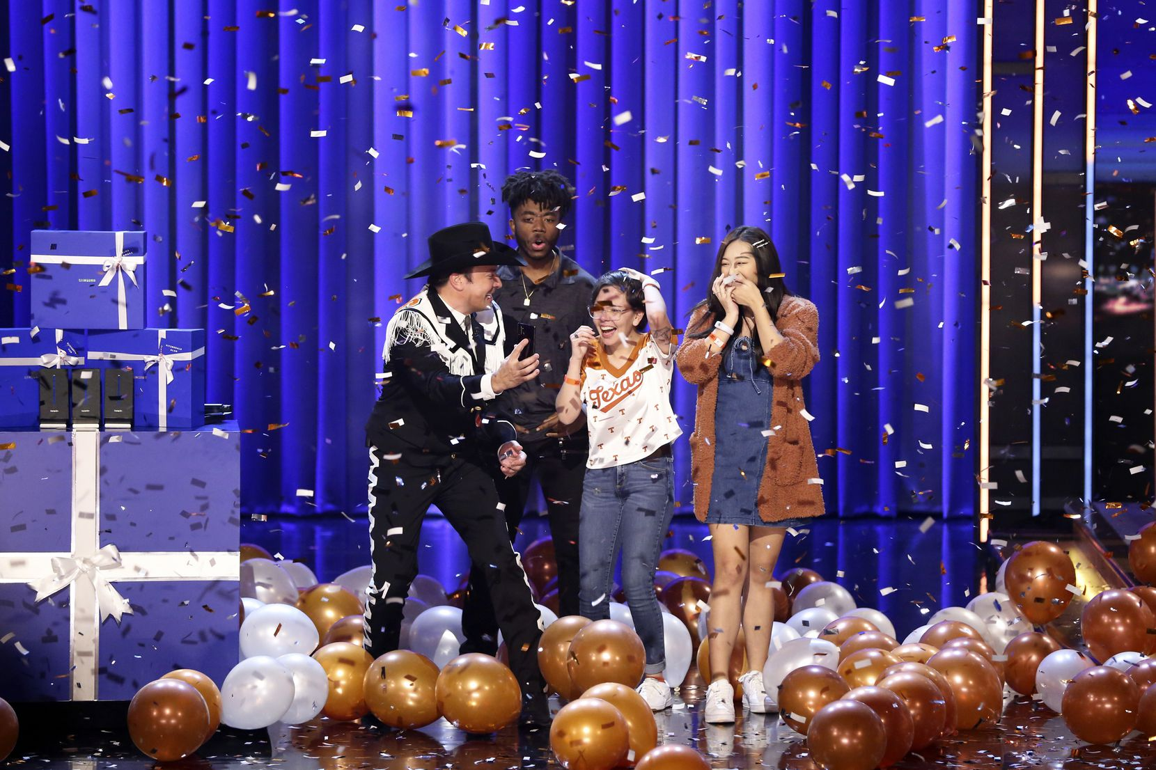 At a taping on Nov. 7, 2019, host Jimmy Fallon told UT Austin students Fitzgerald Alan, Alma Zamora and Elizabeth Yoon that they'd have their college tuition paid for. He also appeared to be wearing a black version of the Longhorn Band uniform.