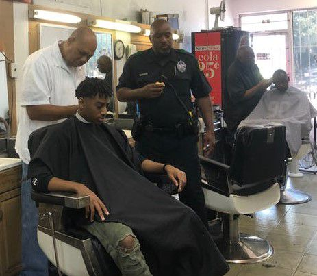 Seventeen-year-old Leighton Douglas gets a haircut during a barbershop talk hosted by Dallas police and Old East Dallas community members in response to a recent wave of violent crime in the area.