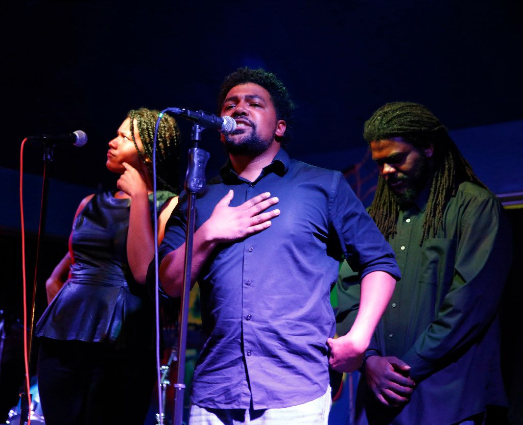 Melania Luisa, (from left) Javon Rustin, and Wayne Henry  perform at a Dallas Poetry Slam open mic. As part of the Dallas Poetry Slam team, they thoroughly rehearse their performances to work in perfect sync.