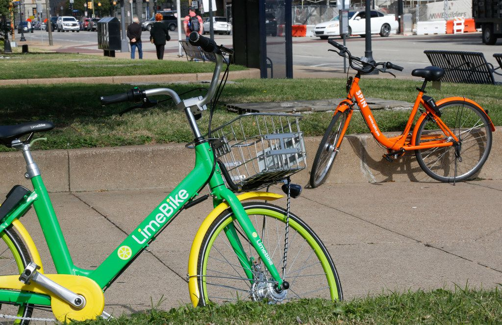 A LimeBike and Spin bike are left in front of Union Station in downtown Dallas on Nov. 1, 2017.
