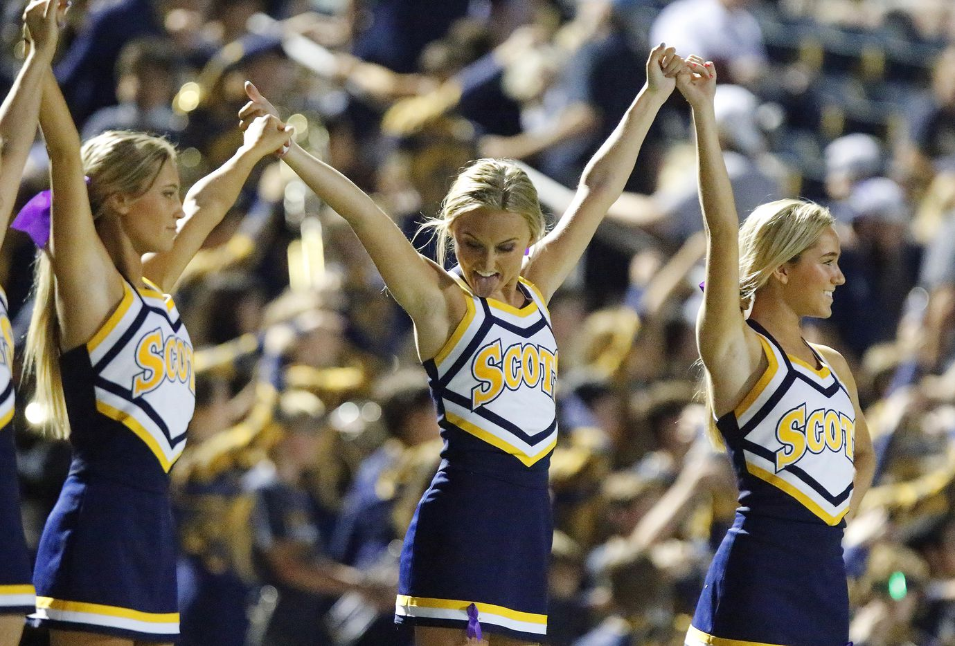 Highland Park cheerleaders Lucy Needleman (center), 17, gets ready for kickoff  as Highland Park High School hosted Longview High School at Highlander Stadium in Dallas on Friday night, October 8, 2021. (Stewart F. House/Special Contributor)