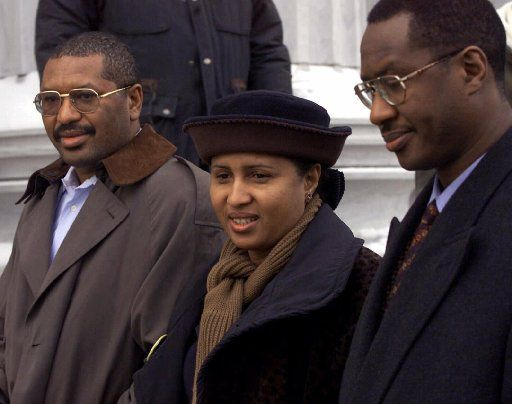 Kadiatou Diallo is flanked by her brothers as she arrives to the courthouse for the murder trial of four police who opened fire on Diallo's son, Amadou.