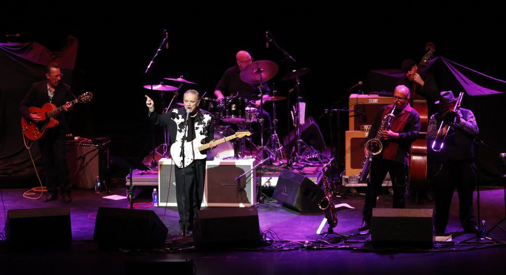 Jimmie Vaughan performs with the Tilt-a-Whirl Band as they opened for the Steve Miller Band at Verizon Theatre in Grand Prairie on Monday.