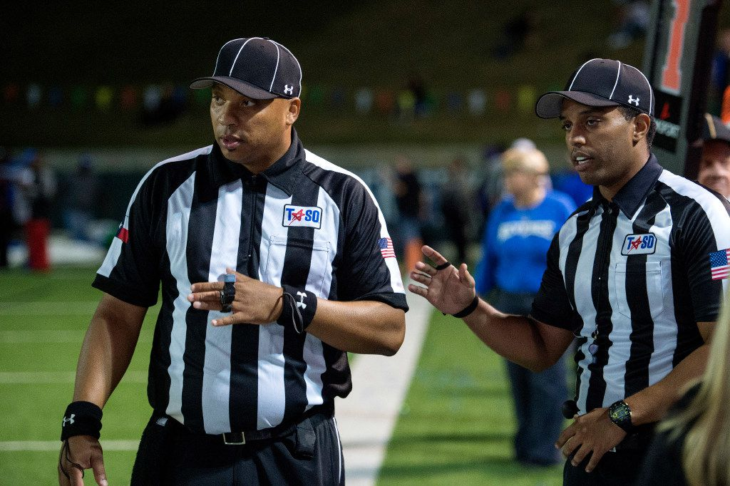 Referees confer on the sidelines in the fourth quarter of a high school football game between Grand Prairie and South Grand Prairie at the Gopher-Warrior Bowl in Grand Prairie, Texas on Friday, September 30, 2016. (Jeffrey McWhorter/Special Contributor)