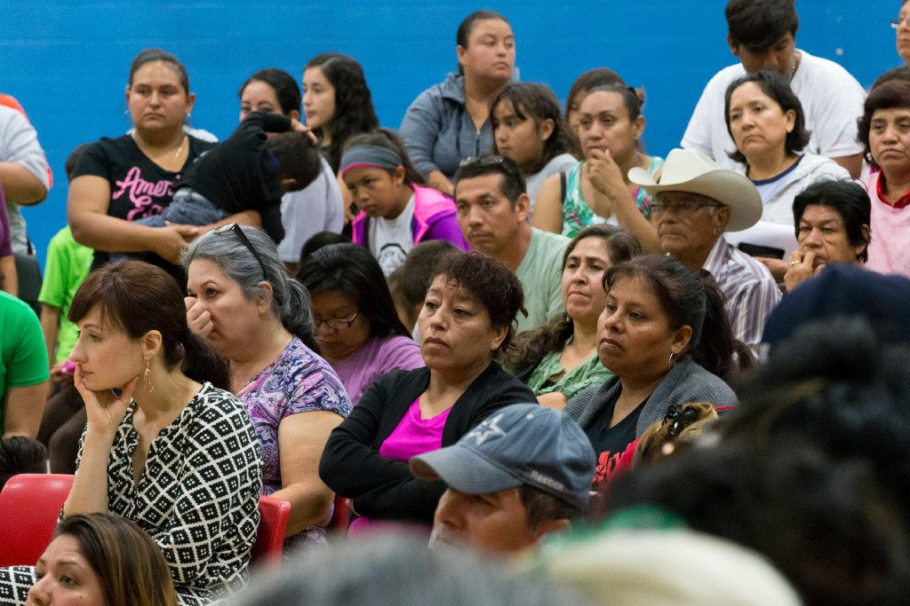 Community members listen to announcements during a community meeting regarding upcoming mass evictions in West Dallas by landlord HMK Ltd. (Ting Shen/Staff Photographer)