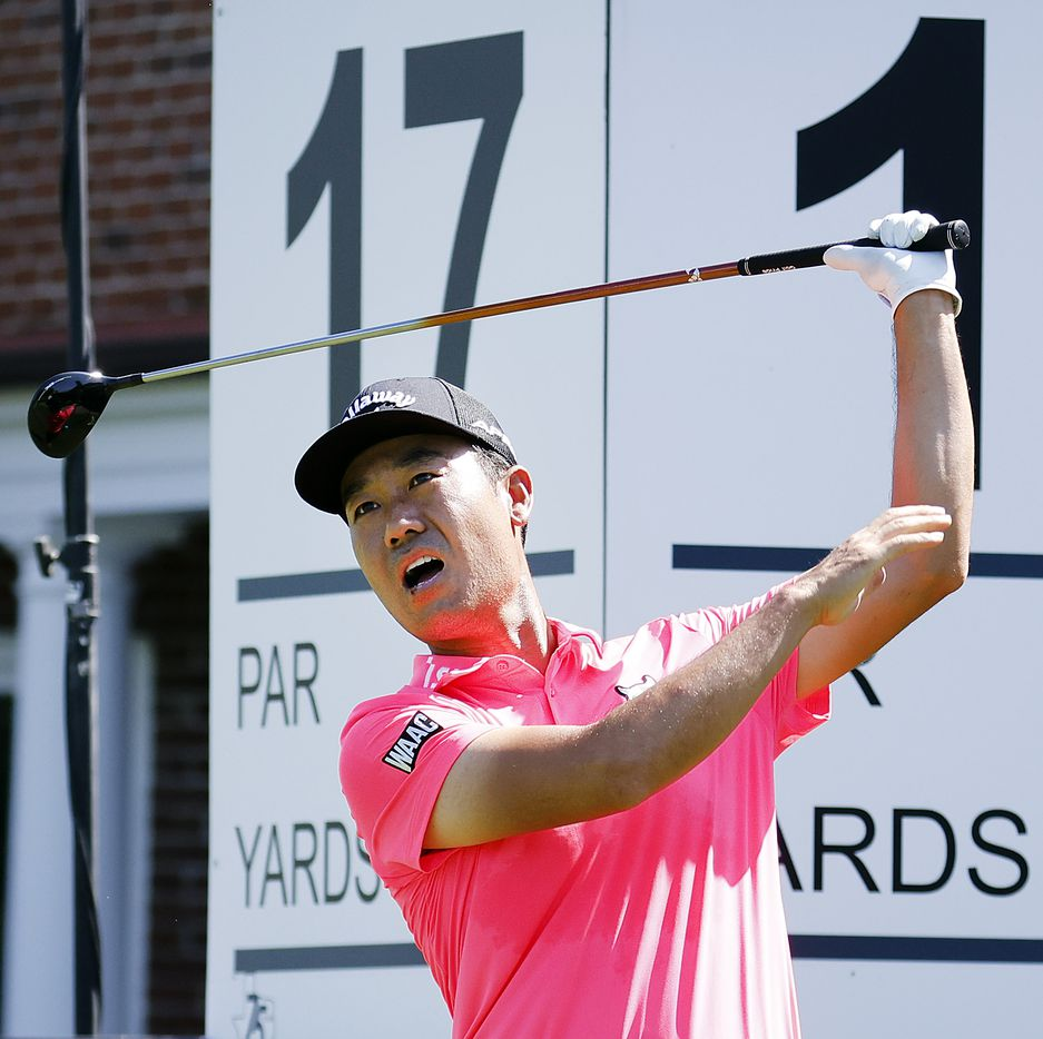 Golfer Kevin Na releases the grip on his club after following through on his swing during the Charles Schwab Challenge Colonial Pro-Am at the Colonial Country Club in Fort Worth, Wednesday, May 26, 2021. Na, who won the tournament in 2019, grabbed for the back of his neck. (Tom Fox/The Dallas Morning News)