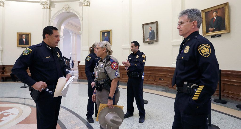 "Houston Police Chief Art Acevedo, left, and San Antonio Police Chief William McManus, right, stand with other law enforcement in the rotunda at the Texas Capitol as they wait to speak against a proposed ""bathroom bill"" at a public safety event, Tuesday, July 25, 2017, in Austin, Texas. The Texas Senate has revived a bill mandating transgender Texans use public restrooms corresponding to their birth-certificate genders. (AP Photo/Eric Gay)"