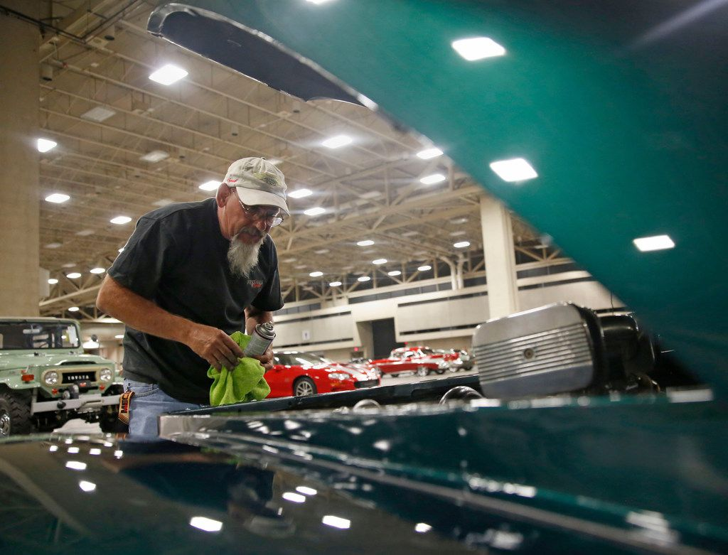 John Sorrentino, Hollywood Wheels auto detailer, inspects his work after detailing the hood of a 1948 Lincoln Continental before the Mecum Auctions event at the Kay Bailey Hutchison Convention Center in downtown Dallas on Tuesday, Oct. 2, 2018. Sorrentino said he gets satisfaction from making something look nice.